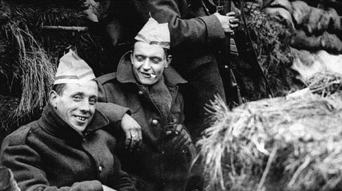 British troops wearing paper Christmas hats on the western front
